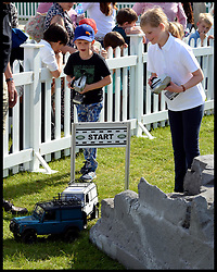 The Earl and Countess of Wessex  daughter Lady Louise Windsor and their son James, Viscount Severn playing with remote controlled land rovers  at the Royal Windsor Horse Show. Windsor, United Kingdom. Wednesday, 14th May 2014. Picture by Andrew Parsons / i-Images