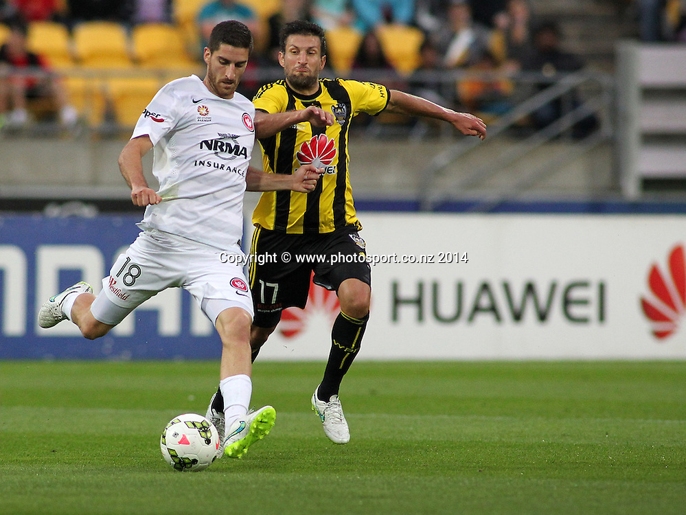 Wanderers Iacopo La Rocca is challenged for the ball by Phoenix Vince Lia during the A-League football match between the Wellington Phoenix & Western Sydney Wanderers at Westpac Stadium, Wellington, 28 December 2014. Photo.: Grant Down / www.photosport.co.nz