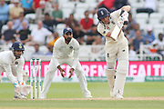 Jos Butler of England drives R Ashwin of India during the 3rd International Test Match 2018 match between England and India at Trent Bridge, West Bridgford, United Kingdon on 21 August 2018.