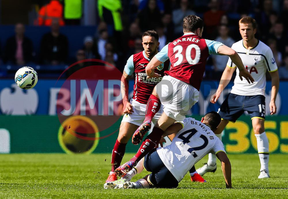 Tottenham Hotspur's Nabil Bentaleb tackles Burnley's Ashley Barnes  - Photo mandatory by-line: Matt McNulty/JMP - Mobile: 07966 386802 - 05/04/2015 - SPORT - Football - Burnley - Turf Moor - Burnley v Tottenham Hotspur - Barclays Premier League