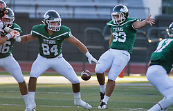 {BLOOMINGTON, IL: Chrystain Maciorowski blocks for punter Brock Krohe during a college football game between the IWU Titans  and the Wheaton Thunder on September 15 2018 at Wilder Field in Tucci Stadium in Bloomington, IL. (Photo by Alan Look)
