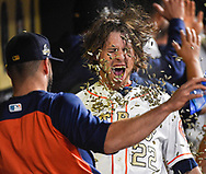 Houston Astros' Josh Reddick (22) is hit with sunflower seeds by Lance McCullers Jr. after Reddick hit a grand slam off of Baltimore Orioles relief pitcher Nestor Cortes Jr. during the seventh inning of a baseball game, Tuesday, April 3, 2018, in Houston. (AP Photo/Eric Christian Smith)