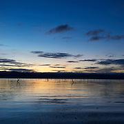 Sunrise at the Srinakarin lake located in Khuean Srinagarindra National Park, Kanchanaburi, Thailand.