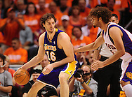 May 23, 2010; Phoenix, AZ, USA; Los Angeles Lakers forward Pau Gasol (16) dribbles the ball against Phoenix Suns center Robin Lopez (15) during the first half in game three of the western conference finals in the 2010 NBA Playoffs at US Airways Center.  Mandatory Credit: Jennifer Stewart-US PRESSWIRE