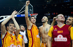 Vlado Ilievski of Macedonia, Damjan Stojanovski of Macedonia, Pero Antic of Macedonia and Gjorgij Chekovski of Macedonia celebrate after the basketball game between National basketball teams of F.Y.R. of Macedonia and Lithuania at Quarterfinals of FIBA Europe Eurobasket Lithuania 2011, on September 14, 2011, in Arena Zalgirio, Kaunas, Lithuania. Macedonia defeated Lithuania 67-65. (Photo by Vid Ponikvar / Sportida)