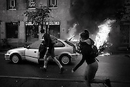 ITALY, Milan: Italian police clashed with protesters at the Milan Expo on May 1 2015, during the parade called  'No Expo Mayday' firing tear gas at the masked demonstrators who had pelted officers with stones and molotov cockatils.Demonstrators set on fire several cars and attacked banks and shops.