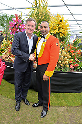 Left to right, PIERS MORGAN and JOHNSON BEHARRY VC at the 2015 RHS Chelsea Flower Show at the Royal Hospital Chelsea, London on 18th May 2015.