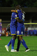 Lyle Taylor AFC Wimbledon and Adebayo Azeez AFC Wimbledon during the Johnstone's Paint Trophy match between AFC Wimbledon and Plymouth Argyle at the Cherry Red Records Stadium, Kingston, England on 1 September 2015. Photo by Stuart Butcher.