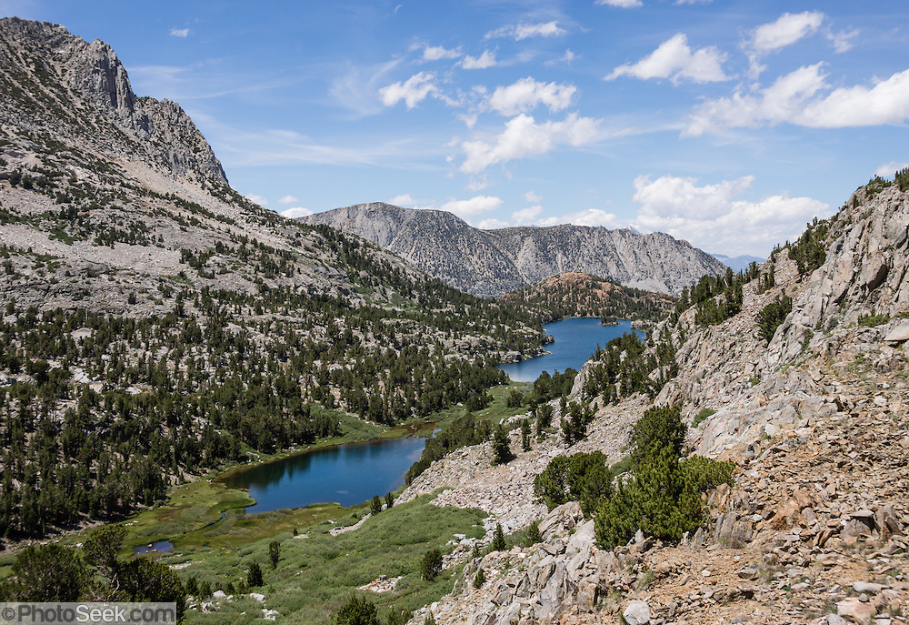 Long Lake. My favorite hike in the Bishop Creek watershed goes from South Lake to Long Lake and Saddlerock Lake, looping back via a steeper, poorly marked route to Ruwau Lake, Chocolate Lakes, and Bull Lake, in John Muir Wilderness, Inyo National Forest, Sierra Nevada, California, USA. The rewarding semi-loop is 9 miles with 2220 feet cumulative gain. An easier walk is 7.2 miles round trip with 1500 feet gain to Saddlerock Lake, out and back via beautiful Long Lake.