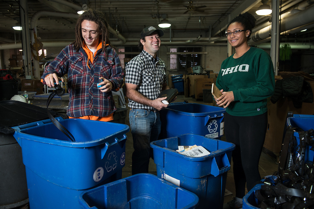 From left, Abraham Kitchen, Andrew Ladd, and Vanessa Thiel sort recyclables at Ohio University's Campus Recycling center on November 15, 2016.