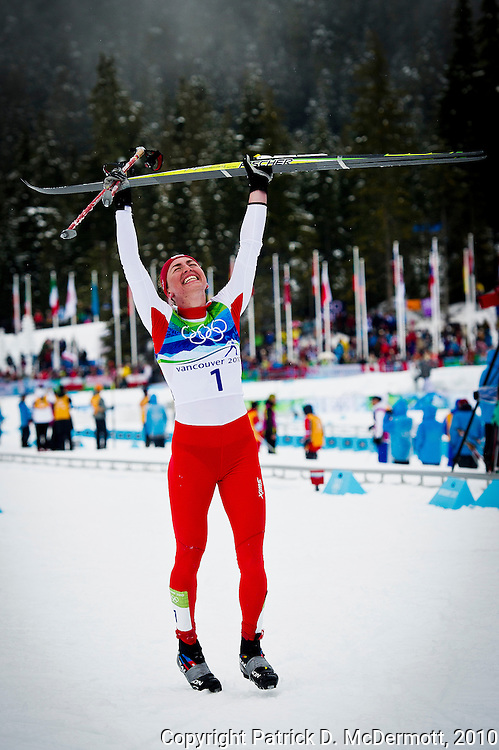 Justyna Kowalczyk, POL, celebrates her victory over Marit Bjoergen, NOR, in the women's cross-country skiing 30 KM mass start classic during the 2010 Vancouver Winter Olympics in Whistler, British Columbia, Saturday, Feb. 27, 2010.