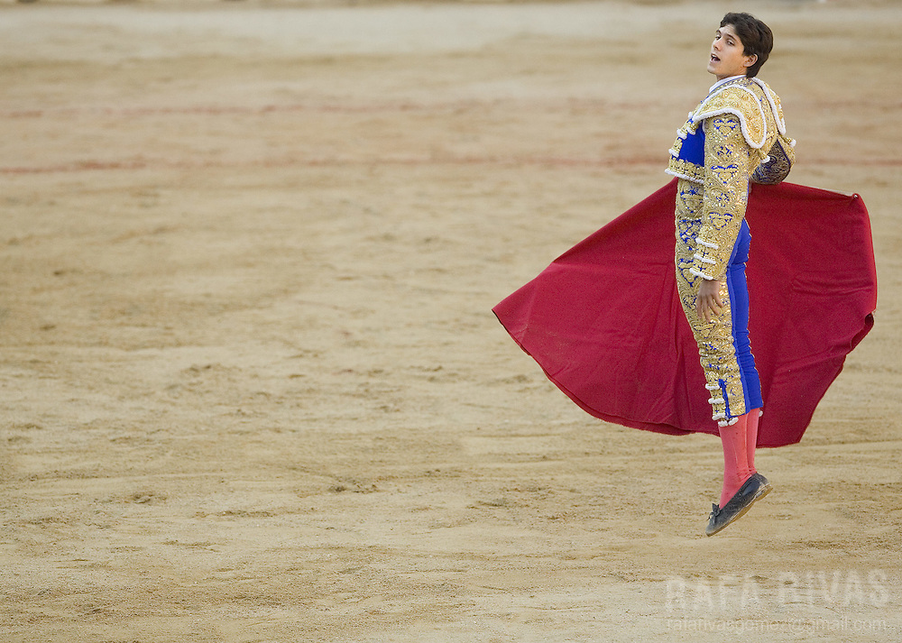 French matador Sebastian Castella jumps to call his Marques de Domecq fighting bull, during the sixth corrida of the San Fermin festivities, 12 July 2007,  in Pamplona, northern Spain.