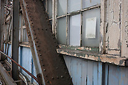A rusting and peeling gantry in the old passenger Tilbury cruise terminal, Essex.