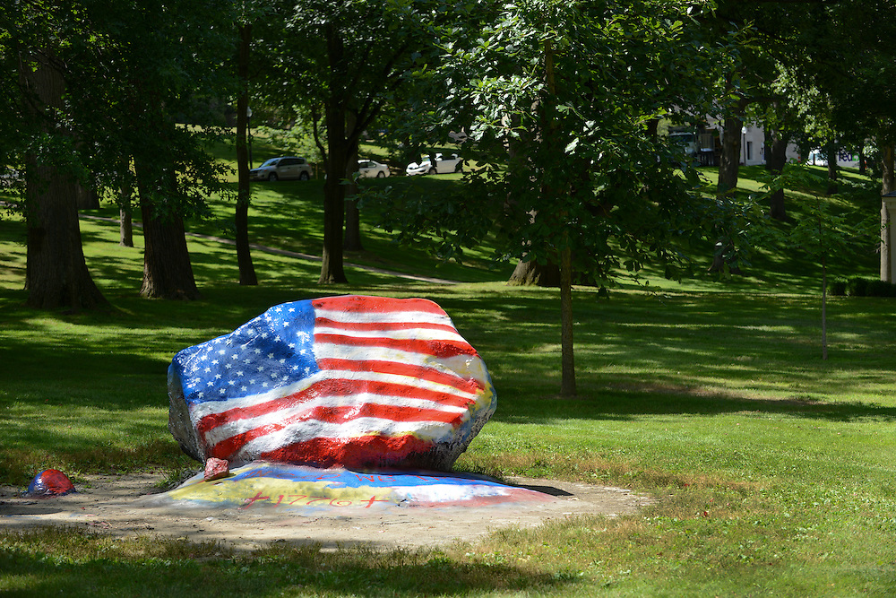 """The Rock"" on Front Campus facing East Main street is a popular feature of the Kent State campus. Student groups have been painting the rock almost nightly since 1930."