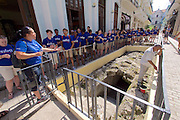 Havana, Cuba. La Habana Vieja (Old Habana). A group of American students visiting excavations.