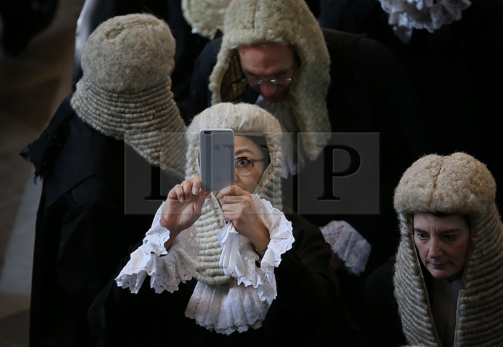 © Licensed to London News Pictures. 01/10/2015. London, UK. A judge takes a phone photograph in Westminster Abbey as she takes part in the annual Judges Service. The Service heralds the start of the legal year in the United Kingdom. Photo credit: Peter Macdiarmid/LNP