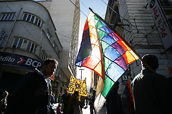 Protestors wave the indigenous flag during a march. Three weeks of protests that have rocked Bolivia led to President Mesa offering his resignation, for the second time this year, to congress. Blockades, protests and concentrations have brought the country to a standstill and confrontations between police and protestors happen daily.  At the center of the conflict is the indigenous movement's desire to nationalize gas and rewrite the constitution. Congress must now meet to decide of they will accept the president's resignation.
