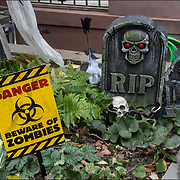 Halloween decorations RIP and Danger Beware of Zombies on side of brownstone in Greenwich Village, NYC.
