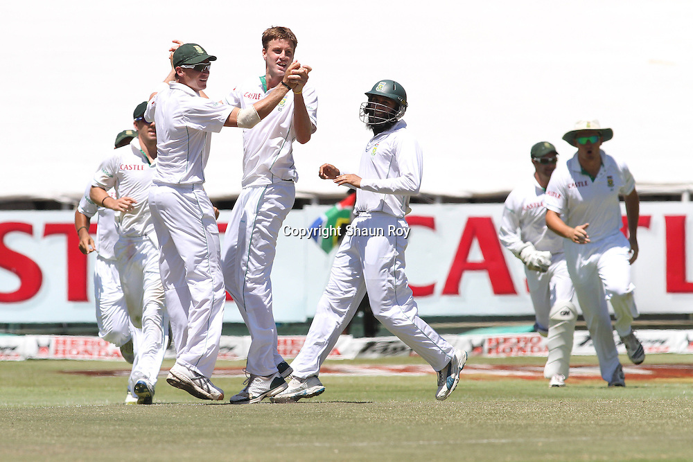 CAPE TOWN, SOUTH AFRICA - 6 January 2011, Dale Steyn of South Africa congratulates Morne Morkel of South Africa on getting the wicket of Virender Sehwag of India during day 5 of the 3rd Castle Test between South Africa and India held at Sahara Park Newlands Stadium in Cape Town, South Africa on the 6 January 2011 .Photo by: Shaun Roy