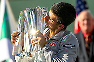 Indian Wells, CA - Novak Djokovic of Serbia kisses the championship trophy at the BNP Paribas Open.