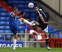 Photo: Paul Thomas.<br /> Oldham Athletic v Swansea City. Coca Cola League 1. 12/08/2006.<br /> <br /> Tom Williams (R) of Swansea clears the ball from Richie Wellens.
