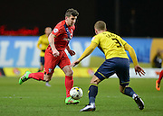York City midfielder Michael Coulson takes on Oxford United Defender Joe Skarz during the Sky Bet League 2 match between Oxford United and York City at the Kassam Stadium, Oxford, England on 1 March 2016. Photo by Adam Rivers.