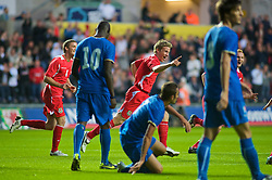 SWANSEA, ENGLAND - Friday, September 4, 2009: Wales' Christian Ribeiro(center) celebrates after scoring Wales' first goal to make it 1-0against Italy during the UEFA Under 21 Championship Qualifying Group 3 match at the Liberty Stadium. (Photo by Gareth Davies/Propaganda)