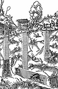 Sectional view of a mine showing shafts and galleries. At surface of each shaft is a winch or windlass for raising and lowering loads. At D a miner wheels a barrow of ore or spoil out of mine through adit with timber reinforced entrance.  From Agricola 'De re metallica' Basle 1556. Woodcut.