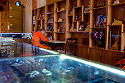 The gift shop of a Buddhist temple in Xishuangbanna, China.