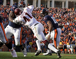 Virginia guard Branden Albert (71) blocks Virginia Tech guard Matt Welsh (51) as quarterback Jameel Sewell (10) runs into the endzone for his second rushing touchdown of the game.  The #8 ranked Virginia Tech Hokies defeated the #16 ranked Virginia Cavaliers 33-21 at Scott Stadium in Charlottesville, VA on November 24, 2007.