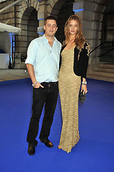 TYRONE WOOD and ROSIE HUNTINGTON-WHITELEY at the Royal Academy of Arts Summer Party held at Burlington House, Piccadilly, London on 3rd June 2009.