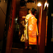 Pontocho is a narrow alley running from Shijo-dori to Sanjo-dori, one block west of the Kamo River. An occasional Geisha can be seen strolling the alley crammed with bars and tea houses frequented by locals and tourists. Photograph by Jose More