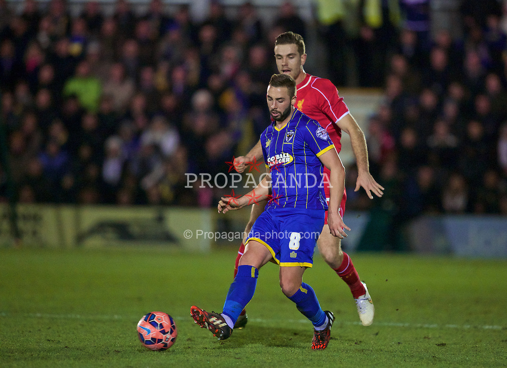 KINGSTON-UPON-THAMES, ENGLAND - Monday, January 5, 2015: AFC Wimbledon's Sammy Moore in action against Liverpool during the FA Cup 3rd Round match at the Kingsmeadow Stadium. (Pic by David Rawcliffe/Propaganda)