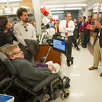 Professor Stephen Hawking, left, listens to a presentation Robert H. Baloh, MD, PhD is the Director of Neuromuscular Medicine in the Department of Neurology, and a member of the Brain Program at the Regenerative Medicine Institute at Cedars-Sinai,  center and Clive Svendsen, PhD, director of the Cedars-Sinai Regenerative Medicine Institute, as they Professor Hawking tours the Regenerative Medicine Institute at Cedars-Sinai Medical Center on Tuesday, April 9, 2013.  Photo by Cedars-Sinai Medical Center