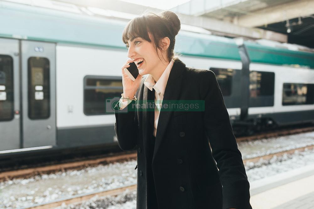 February 24, 2017 - Businesswoman using mobile phone in train station, Milan, Italy (Credit Image: © Eugenio Marongiu/Image Source via ZUMA Press)