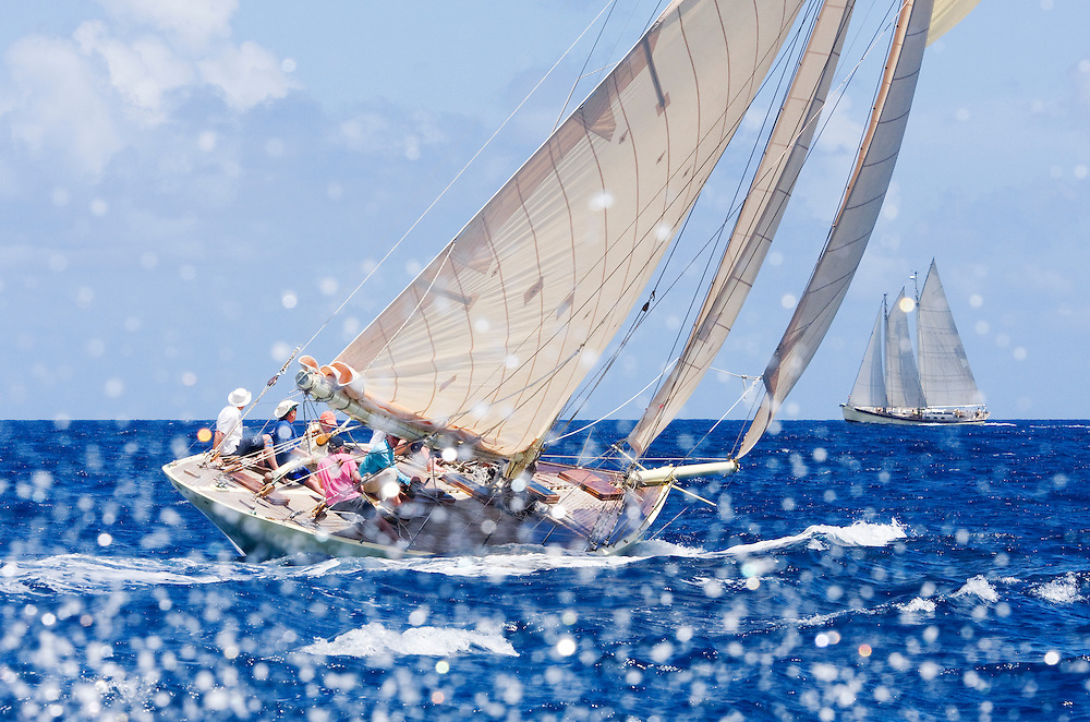 Waves splash as the gaff rigged cutter SY Kate sails during the 2008 Antigua Classic Yacht Regatta. This race is one of the worlds most prestigious traditional yacht races. It takes place annually off the costa of Antigua in the British West Indies.