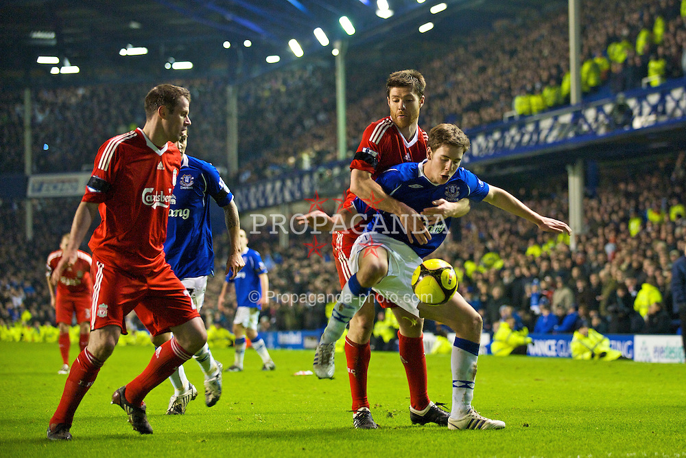 LIVERPOOL, ENGLAND - Wednesday, February 4, 2009: Liverpool's Xabi Alonso and Everton's Dan Gosling during the FA Cup 4th Round Replay match at Goodison Park. (Mandatory credit: David Rawcliffe/Propaganda)