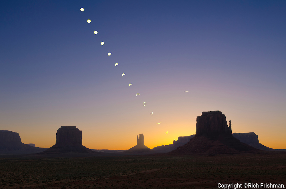 Time-lapse photograph of the annular eclipse of the sun over Monument Valley showing the phases of the eclipse against the stunning backdrop of this iconic desert landscape;  Arizona, USA, North America on 20 May 2012. The monoliths central to the photo are (l/r) Merritt Butte, West Mitten and East Mitten..