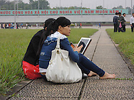 Young Vietnamese couple sit together on the grounds of Ho Chi Minh Mausoleum, Hanoi, Vietnam, Southeast Asia
