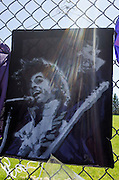 Poster or tapestry of Prince performing with sun streaks coming from the top. Paisley Park Studios Chanhassen Minnesota MN USA