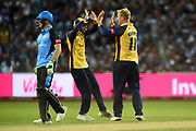 Simon Harmer and Aron Nijjar of Essex Eagles celebrate the wicket of Ben Cox during the Vitality T20 Finals Day 2019 match between Worcestershire County Cricket Club and Essex County Cricket Club at Edgbaston, Birmingham, United Kingdom on 21 September 2019.