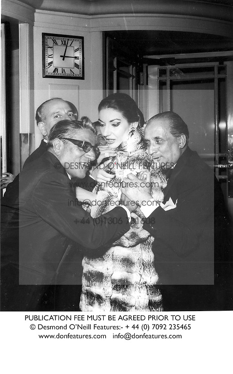 Left to right, ARISTOTLE ONASSIS, MARIA CALLAS and her husband SIGNOR GIOVANNI MENEGHINI at a party at The Dorchester, London in June 1959.  CCJ 60PUBLICATION FEE MUST BE AGREED PRIOR TO USE<br /> &not;&copy; Desmond O&sbquo;&Auml;&ocirc;Neill Features:- + 44 (0) 7092 235465<br /> www.donfeatures.com   info@donfeatures.com