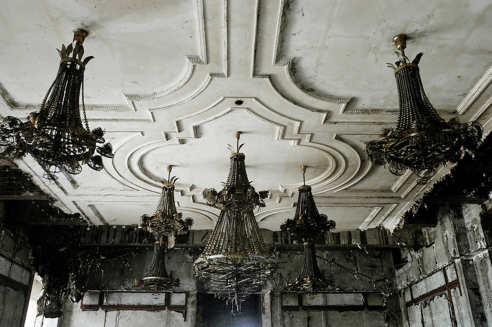 Chandeliers too heavy to loot in the remains of the Bamboo Palace, one of the extravagant residences built by Mobutu Sese Seko and used primarily for public functions in his native village in Equateur Province..Gbadolite, DR Congo. 17/03/2009.Photo © J.B. Russell