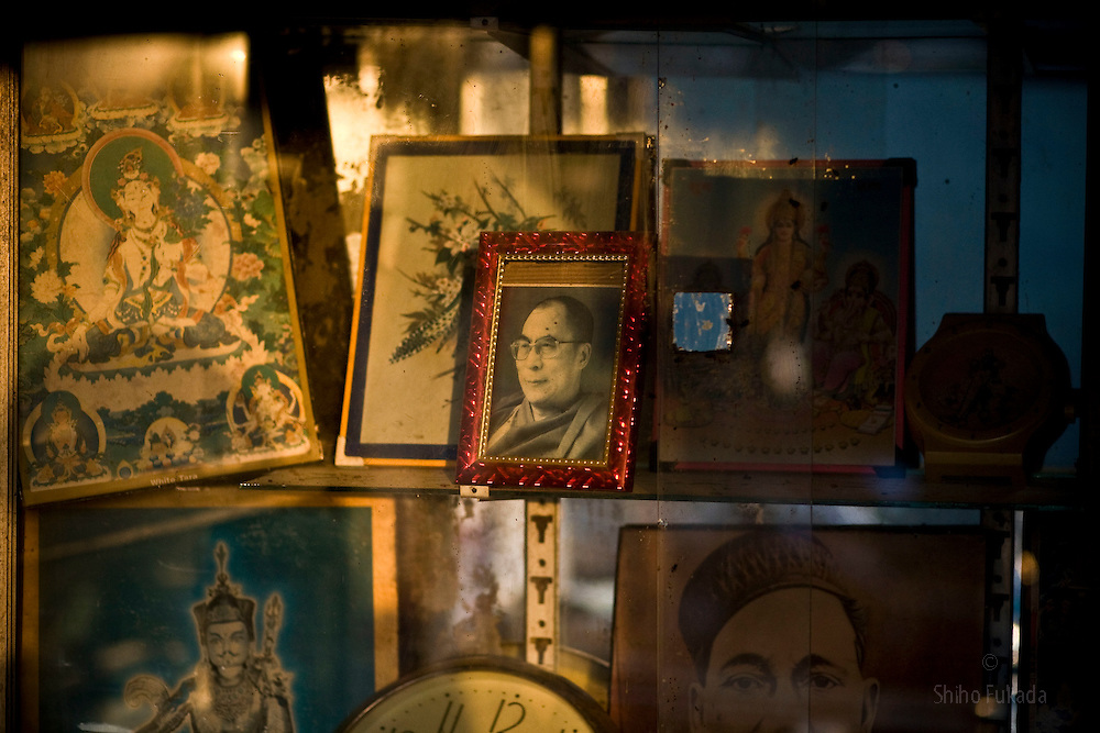 A picture of Dalai Lama is seen in McLeod Ganj, Dharamsala, India, where the Dalai Lama settled after fleeing Tibet in 1959 after a failed uprising against Chinese rule, May 27, 2009.