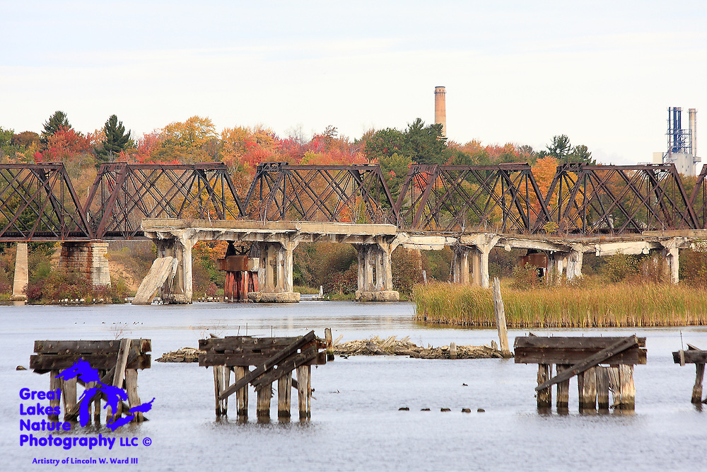The Escanaba River flows through the ruins of several old railroad bridges on its way to Little Bay de Noc. These ruins provide a subtle hint of the significance of rail transport in the history of the area.<br /> <br /> Today, the river provides an important access to Little Bay de Noc, which is a mecca for trophy walleye anglers. This image was captured from Escanaba's North Shore Fishing Complex; one of the premier fishing-oriented boat launching facilities in the Midwest.
