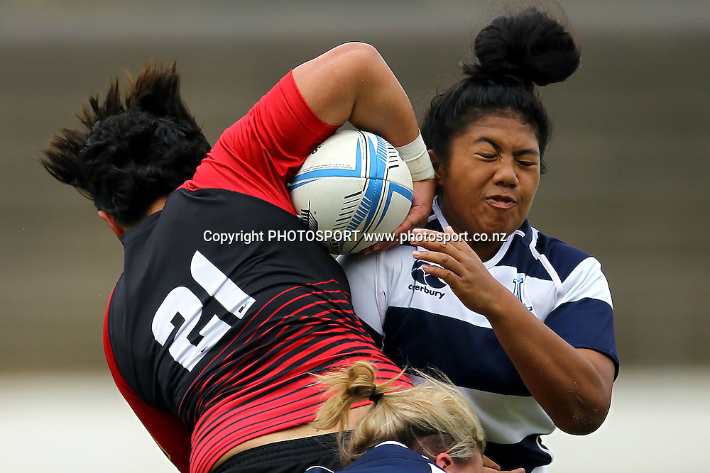 Auckland's Onjeurlina Leiataua takes a hit from Canterbury's Jerusha Whiley. 2013 Women's Provincial Championship, Auckland Storm v Canterbury at Western Springs,  Auckland, New Zealand. Saturday 7th September 2013. Photo: Anthony Au-Yeung / photosport.co.nz