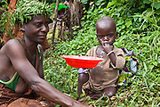 A mother and son of the traditional Batwa tribe from the Bwindi Impenetrable Forest in Uganda. They were indigenous forest nomads before they were evicted from the Bwindi Impenetrable Forest when it was made a World Heritage site to protect the mountain gorillas.  The Batwa Development Program now supports them.