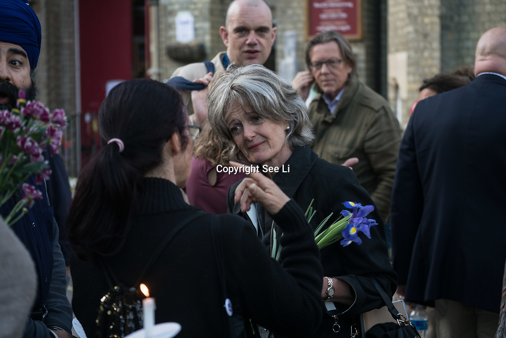 London, England, UK. 27th July 2017. Cllr Elizabeth Campbell, Leader of Kensington and Chelsea Council of the Grenfell fire investigation attend a memorial for Grenfell Tower victims and question by local outside St Clements Church.