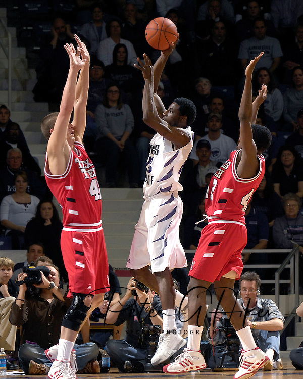 Kansas State guard Jermaine Maybank (C) puts up a shot during the first half between Texas Tech defenders Charlie Burgess (R) and Damir Suljagic (L) at Bramlage Coliseum in Manhattan, Kansas, January 8, 2007. Texas Tech defeated K-State 62-52.