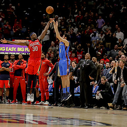 Dec 12, 2018; New Orleans, LA, USA; Oklahoma City Thunder guard Alex Abrines (8) misses a three point basket over New Orleans Pelicans forward Julius Randle (30) in the final second of the fourth quarter at the Smoothie King Center. Mandatory Credit: Derick E. Hingle-USA TODAY Sports